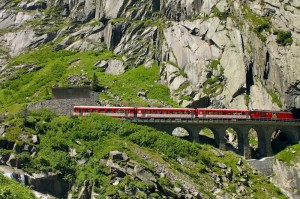 Red Train Goes Through Mountains